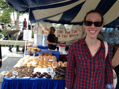 Me in front of the Vegan Treats tent with lots of vegan doughnuts in the background!