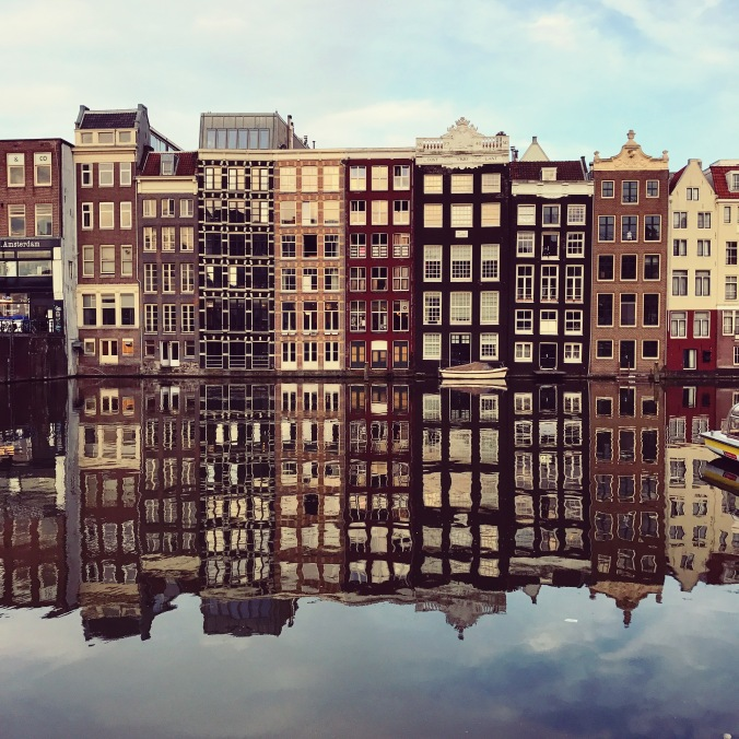 Amsterdam houses with reflections in the canal; copyright Kelly Williams