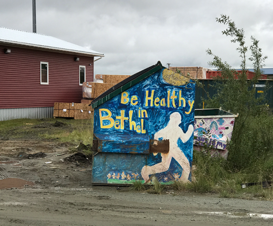 """Be Healthy in Bethel"" public artwork on a dumpster in Bethel, Alaska"